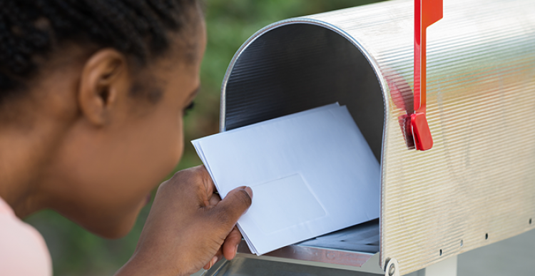 Opening Mailbox for Direct Mail From Fund Raising Strategies
